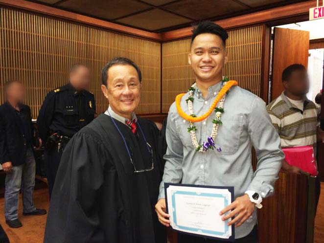 Kenneth Legaspi is pictured above (right) with presiding District Court Judge David Lo (left).