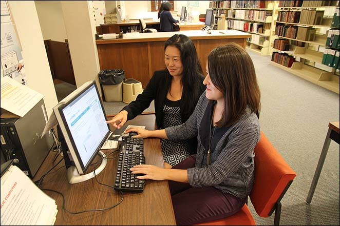 Supreme Court State Law Librarian Jenny R.F.F. Silbiger (left) and Elise von Dohlen, Legal Aid Society of Hawaii's Director of Grants Management (right), test the new Hawaii Self-Help Interactive Forms on Legal Aid's LawHelp.org website.