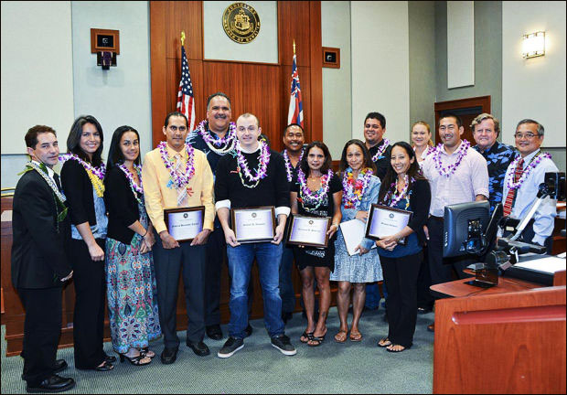 The nine graduates of the Kauai Drug Court take a group photo with well-wishers.