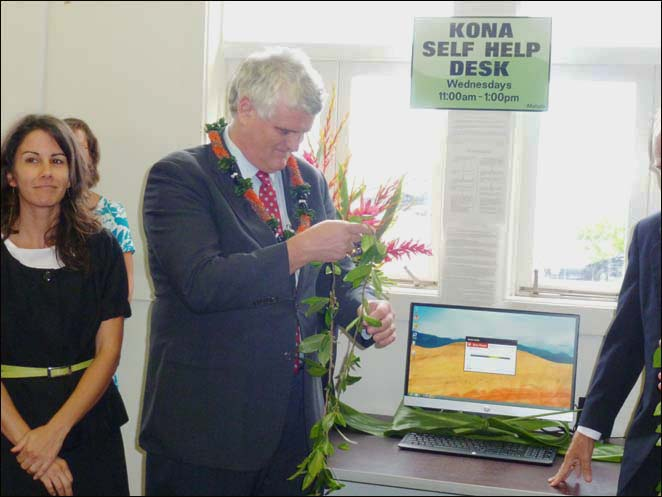 Chief Justice Mark Recktenwald untied the maile lei officially launching the new self-help desk at the Kona courthouse.