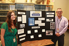Two law library staff stand next to Law Day 2016 Miranda More Than Words display
