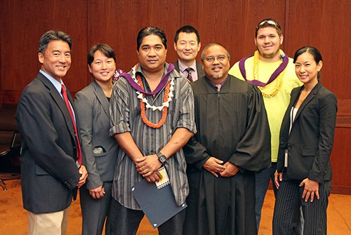 Two DWI Court graduates with judge and others.