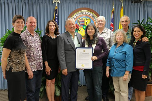 City & County of Honolulu Managing Director Roy Amemiya, Jr. with proclamation surrounded by 8 alternative dispute resolution practitioners.