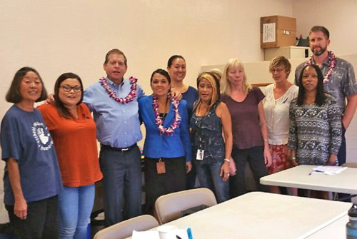 Second Circuit Family Court Judge Lloyd A. Poelman (third from the left) and Second Circuit District Court Judge Adrianne Heely (fourth from the left) join fellow presenters and event organizers to celebrate the success of their October 26, 2016 Outreach Workshop for the Lanai Keiki Network and the Lanai community.
