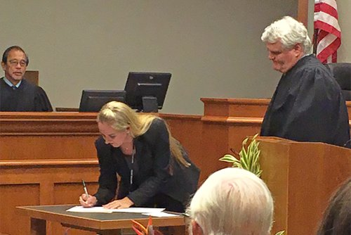 Judge Frenz signs the oath of office 10/31/2016.