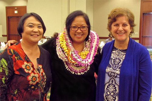 Debi S. Tulang-De Silva, Program Director of the Hawaii State Judiciary's Office on Equality and Access to the Courts (center), is joined by OEAC Court Interpreting Services Coordinator, Melody Kubo (left), and Susan Pang Gochros (right) after receiving the HSBA's prestigious Golden Gavel Award for 2016.
