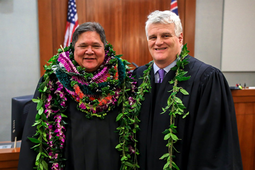 Judge Michael K. Soong (left) is congratulated by Chief Justice Mark E. Recktenwald (right) on being sworn-in to serve as judge in the District Court of the Fifth Circuit (Island of Kauai) on January 3, 2017.