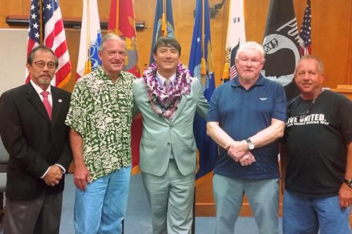 Photograph celebrating the third graduate of the  Kona Big Island Veterans Treatment Court .