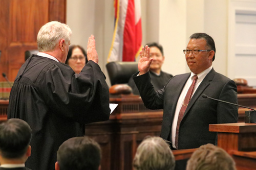 Chief Justice Mark E. Recktenwald administers the oath of office to Derrick Chan,  Hawaii's newly appointed Intermediate Courts of Appeal associate judge.