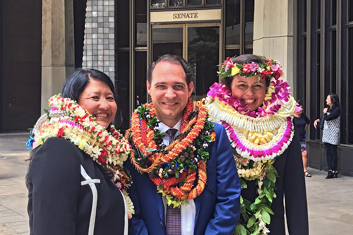 A group photograph of Darolyn Lendio Hein, Brian Costa, and Trish Morikawa after their Senate Confirmation hearing.