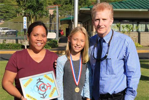 First Circuit Court Chief Judge R. Mark Browning congratulates a student for winning an annual poster contest.  Her teacher is also in the photograph.