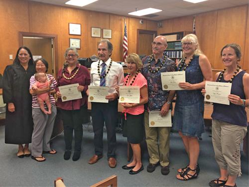 Volunteer mediators recieve certificates of recognition for their work.