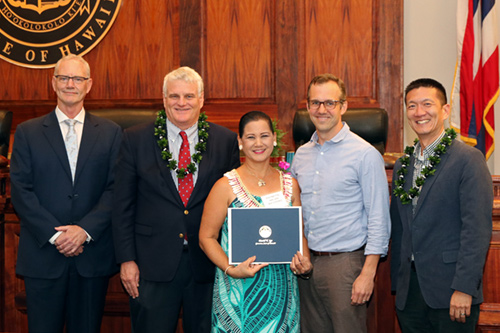 Group photograph of Raynette Ah Chong (center) receiving an award at the Hawaii Pro Bono Awards in 2017.