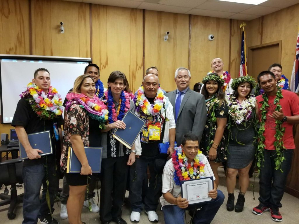 Kona Drug Court graduates celebrate their accomplishments with Judge Melvin Fujino.