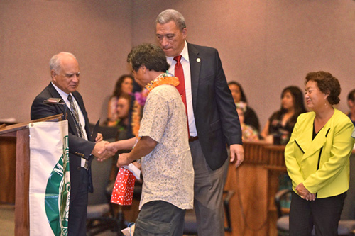 Second Circuit Chief Judge Joseph Cardoza (left) is joined by Judge Richard Bissen (center) and Judge Rhonda Loo (right) in congratulating one of the Maui/Molokai Drug Court's 17 graduates at the November 9 graduation ceremony. The court also celebrated a milestone by commemorating the success of the 607 individuals who have completed the program since it began in 2000.