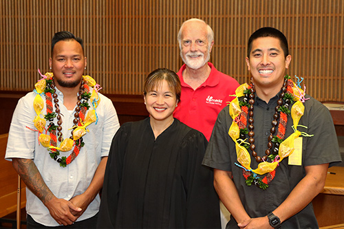 Honolulu DWI Court Judge Melanie May and Mr. Arkei Koehl of Mothers Against Drunk Driving (MADD) with two DWI Court graduate, May 10, 2018.