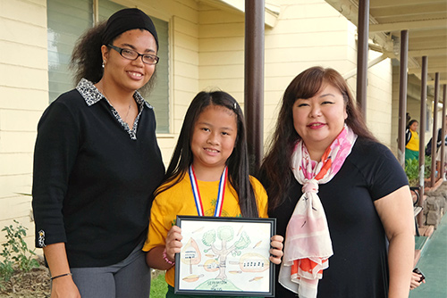 A picture of one of the winners of the First Circuit Court's 2018 Poster Contest from St. John the Baptist Catholic Schoos