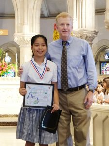 2018 First Circuit Law Day Art contest winner in the Fourth-Fifth grade category, Juliana Shi (second place) of  St. Andrew's School, is pictured here with Chief Judge R. Mark Browning.