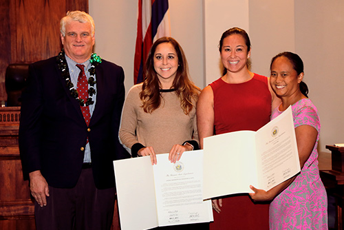 A photograph of local attorneys who were awarded for volunteering to provide free legal assistance in the Judiciary's Access to Justice Rooms.
