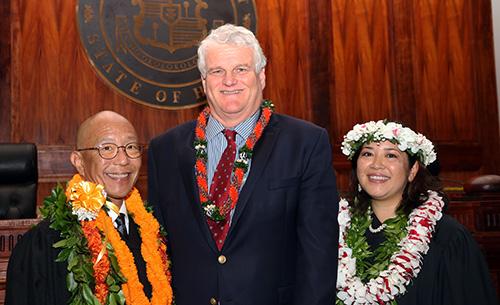 Chief Justice Mark E. Recktenwald congratulates Judge Keith K. Hiraoka, left, and Judge Summer Kupau-Odo.