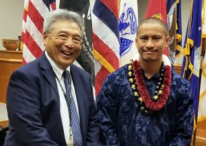 Third Circuit Chief Judge and Veterans Treatment Court Judge Greg Nakamura is all smiles as he congratulates the program's 12th graduate during a February 7, 2019 ceremony.