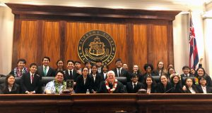 Photo of Chief Justice Mark E. Recktenwald and the Moanalua High School Blue team.