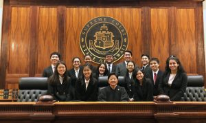 Photo of Internmediate Court of Appeals Chief Judge Lisa M. Ginoza and the Pearl City High School White team.