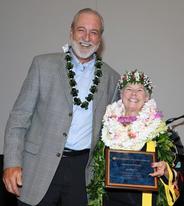 Photo of Steve Holmberg, MCP's board president, presents Dee Dee Letts with a Champions Award.