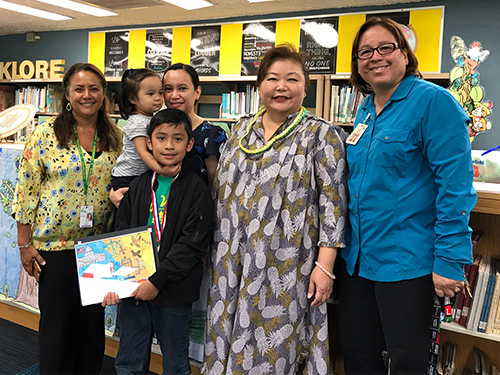 2019 First Circuit Law-Day Poster Contest 3rd place winner Enzo Miguel DeLeon, teacher Stacy Batoon, Enzo's family, First Circuit Chief Court Administrator Lori Okita, and Principal Michelle DeBusca.