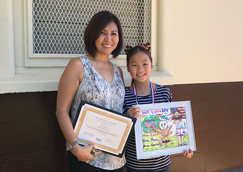 2019 First Circuit Law-Day Poster Contest Second place winner Julie Kang with her teacher Lisa Darcey at Liholiho Elementary award ceremony.