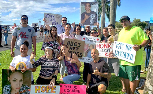 "Hilo Drug Court volunteers at the 05/15/19 National Drug Court Month ""Drug Abuse and Suicide Prevention Sign Waving"" event."