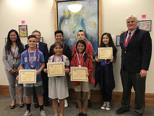 Student winners of the Third Circuit Law Day 2019 Poster Contest with Third Circuit Family Court Judge Darien W. L. Ching Nagata, Third Circuit Chief Judge Greg K. Nakamura, and Hawaiʻi Supreme Court Chief Justice Mark E. Recktenwald, 05/20/2019
