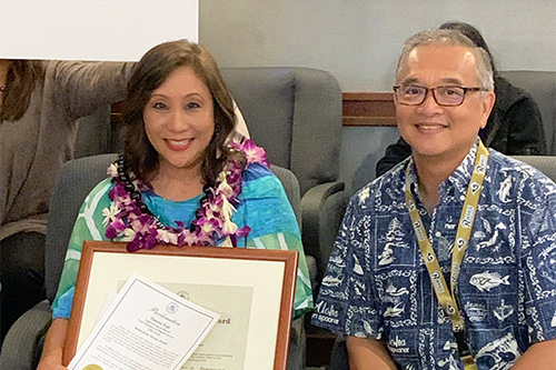 Danette Fujii, Court Documents Clerk, Court and Operational Support Services Division, Fifth Circuit (Kauai) Legal Documents Branch, with Fifth Circuit Chief Judge Randal G.B. Valenciano, at the Pu`uhonua Kaulike Building, Kauai Judiciary Complex, 09/30/2019.