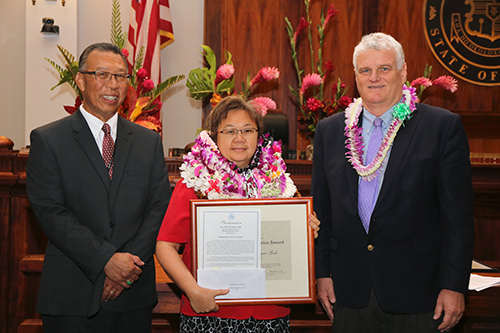 Yee Nin Evelyne Luk, Court Administrator of the Legal Documents Branch in the First Circuit's Honolulu District Court, with Intermediate Court of Appeals Associate Judge Derrick H.M. Chan and Hawaii Supreme Court Chief Justice Mark E. Recktenwald, in the Supreme Court courtroom, 09/30/2019.
