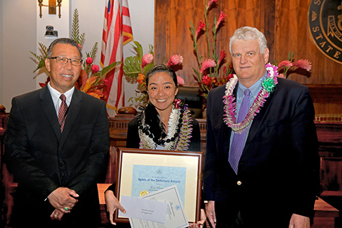 Lori Tamanaha, Social Worker IV / TRO Court Officer, Adult Client Services Branch / TRO unit, First Circuit (Oahu) Family Court - Kapolei, with Intermediate Court of Appeals Associate Judge Derrick H.M. Chan and Hawaii Supreme Court Chief Justice Mark E. Recktenwald, in the Supreme Court courtroom, 09/30/2019.