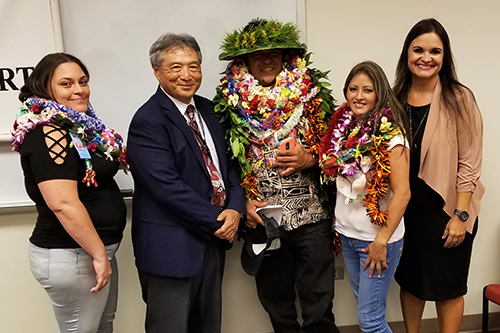 Chief Judge Greg Nakamura with three Big Island Drug Court graduates and Public Defender Sherilyn Tavares at the 48th graduation ceremony, August 29, 2019.