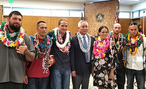 Judge Melvin H. Fujino in his courtroom at the Keahuolu Courthouse in Kona with six Big Island Drug Court graduates at the 49th graduation ceremony, October 7, 2019.