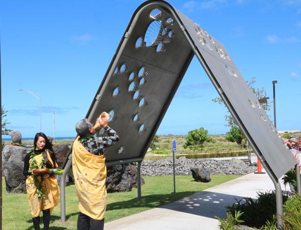 Kahu Danny Akaka, Jr., and daughter, Kalei, bless the Creating Kamaʻāaina sculpture by Matthew Salenger, 10-01-2019.