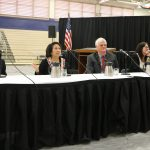 Hawaii Supreme Court Associate Justice Richard W. Pollack, Associate Justice Paula A. Nakayama, Chief Justice Mark E. Recktenwald, Associate Justice Sabrina S. McKenna, and Associate Justice Michael D. Wilson sitting at a table in the gym at Waipahu High School's Courts in the Community event, 11/14/2019.