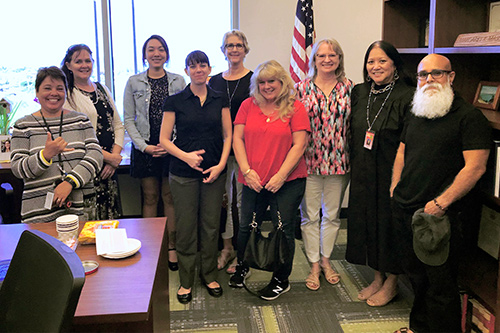 Judge Margaret Masunaga and law librarian Lisa Rosile with seven librarians who visited the Keahuolu Courthouse Law Library, 03/02/20.
