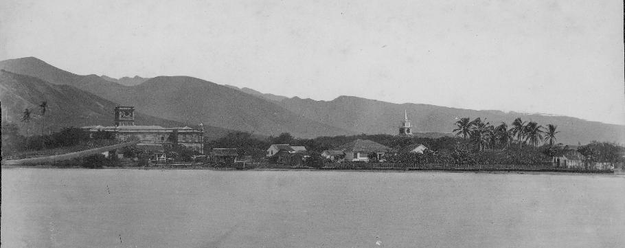 1885 photo from the ocean. View of shoreline with Aliiolani Hale on left and Kawaiahao Church on the right.