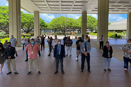 First Circuit Drug Court Judge Matthew J. Viola stands with Drug Court staff and 15 graduates at the 72nd Oahu Drug Court graduation ceremony on 06/15/2020 at the Kaahumanu Hale Courthouse Building. All stand six feet apart and are wearing masks.