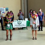 Fifth Circuit Deputy Chief Judge Michael K. Soong stands with 10 graduates at the 35th Kauai Drug Court graduation ceremony on 05/29/2020 at the Kauai Courthouse. All stand six feet apart and are wearing masks.