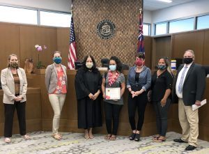 Photograph of court staff with the newest graduate of the Kona Jail Diversion Program