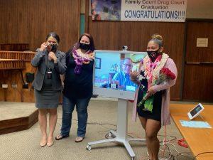 Photo of Judge Adrianne Heely and graduates.
