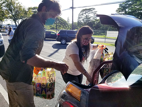Photo of people loading gifts into car trunk