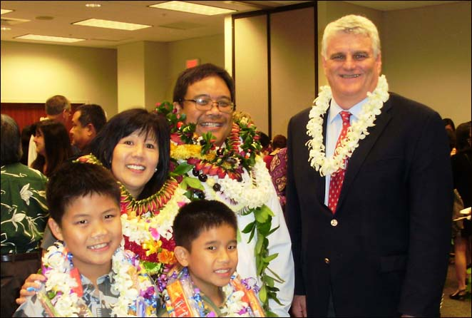 Pictured with Judge Nakamoto and Chief Justice Recktenwald are Judge Nakamoto's wife, Joyce, and sons Timothy (age 11) and Jordan (age 9).