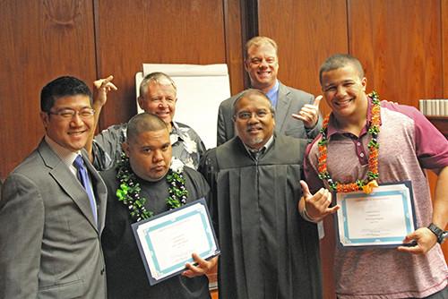 Judge Domingo and 3 attorneys congratulate 2 DWI Court graduates April 21, 2016.