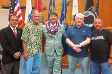 Third Circuit Chief Judge Ronald Ibarra (left), Veterans Treatment Court mentor, and supporters with the Big Island Veterans Treatment Court's third graduate (middle).