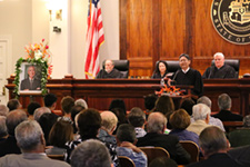 Intermediate Court of Appeals Chief Judge Craig H. Nakamura at the Supreme Court podium. At the bench, Associate Justice Richard Pollack, Associate Justice Paula A. Nakayama, and Chief Justice Mark E. Recktenwald.